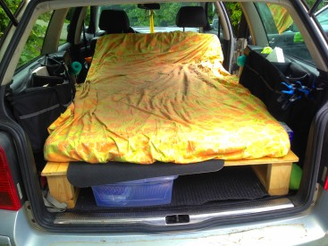 The bed frame allows me to easily slide 2 big totes, one clothes and one cooking stuff and tools.